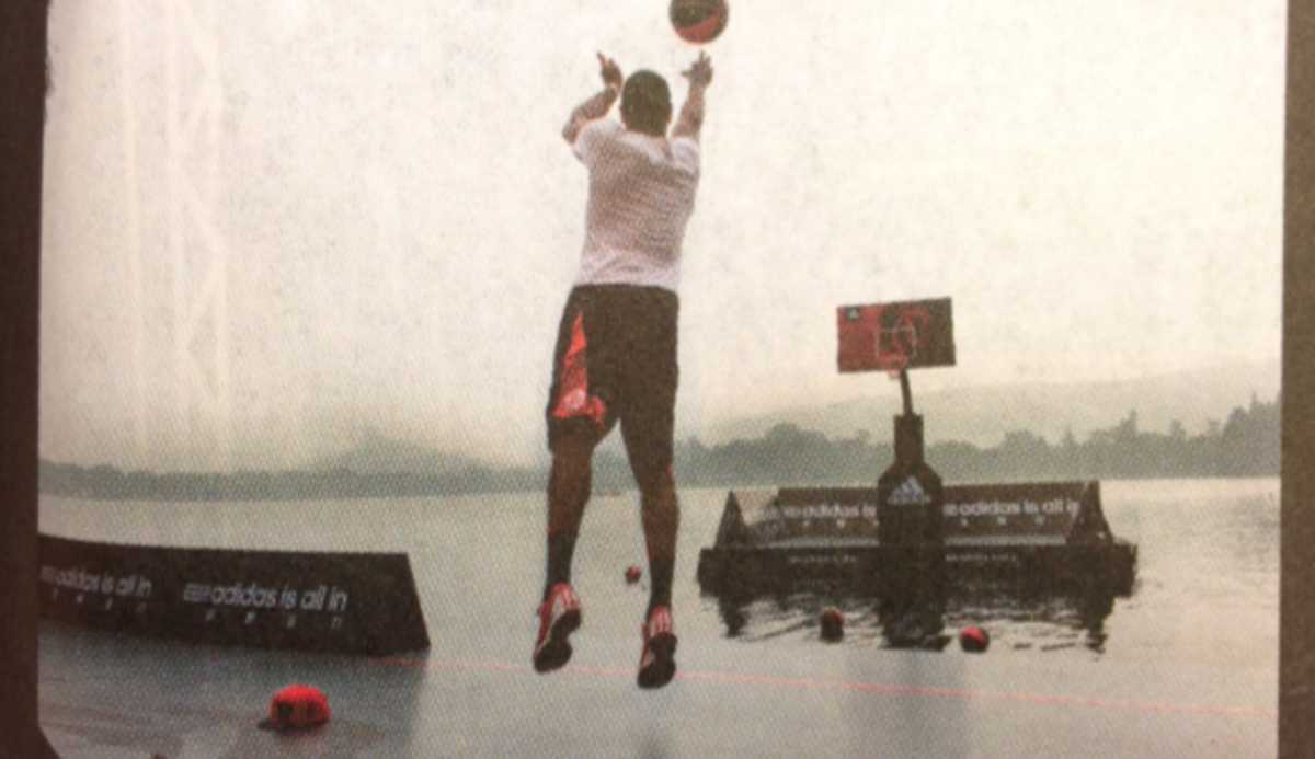 Derrick Rose, attempting a shot on a court built on the port of one of Hong Kong's many islands