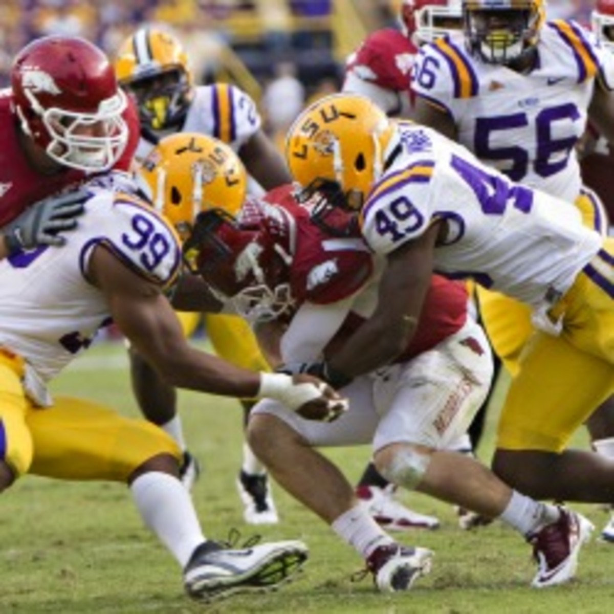 LSU's Sam Montgomery (left) and Barkevious Mingo (right) say they've bet (Wesley Hitt/Getty Images)