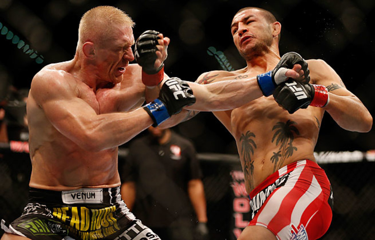 After a slow start, Cub Swanson (right) gained momentum to defeat Dennis Siver with a third-round TKO.