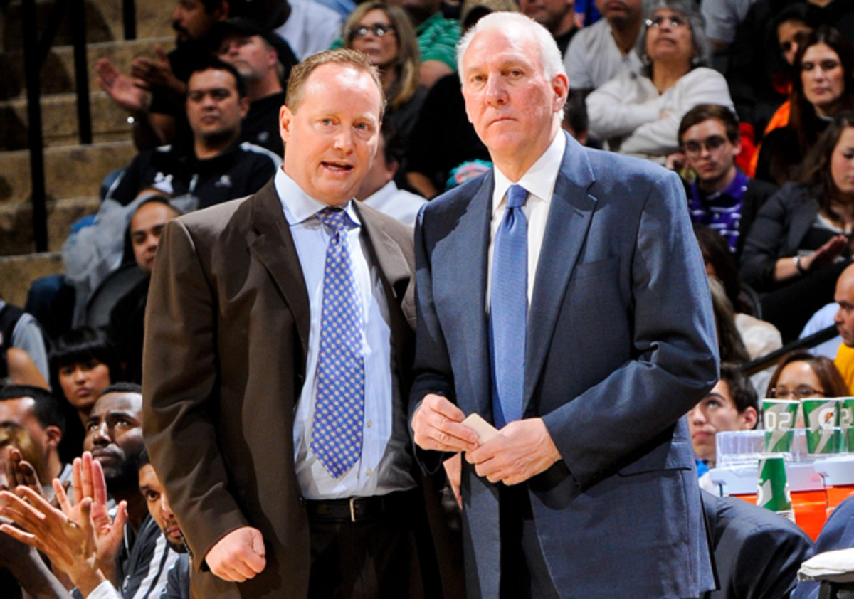 Mike Budenholzer (left) is leaving the Spurs after nearly two decades. (D. Clarke Evans/Getty Images)