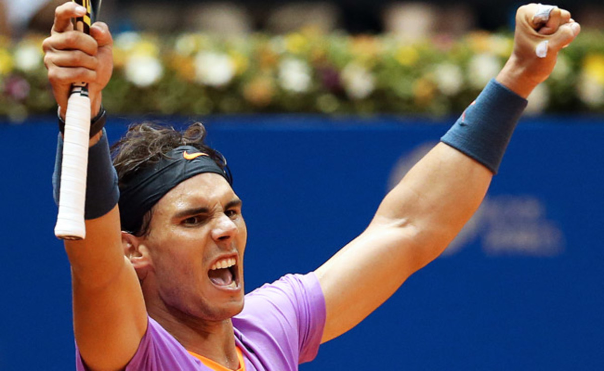 Rafael Nadal celebrates after defeating Martin Alund 6-3, 6-7 (2), 6-1 at the Brazil Open.