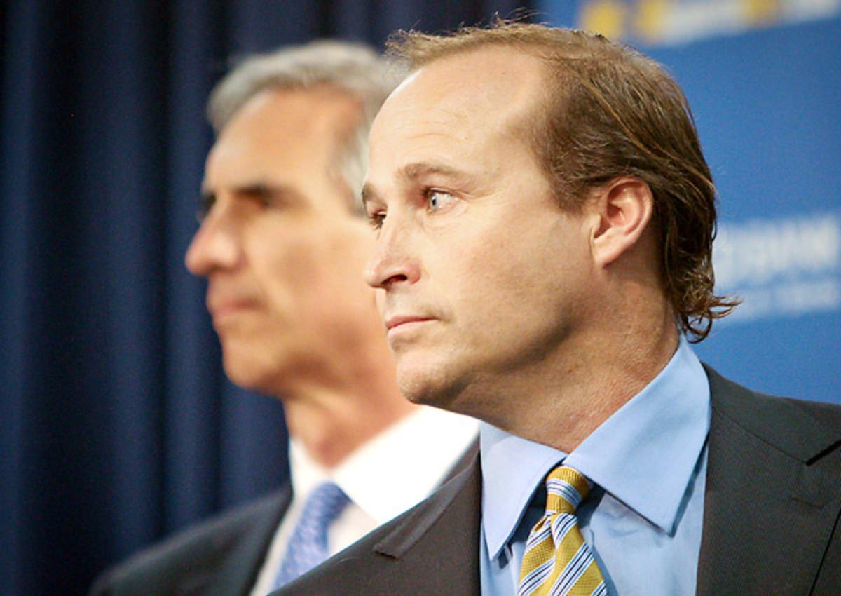 Oliver Luck (left) made Dana Holgorsen West Virginia's head coach in 2011.