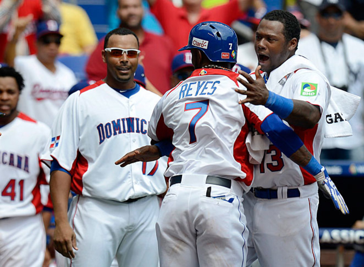 Jose Reyes homered to help the Dominicans win their Pool 2 opener.