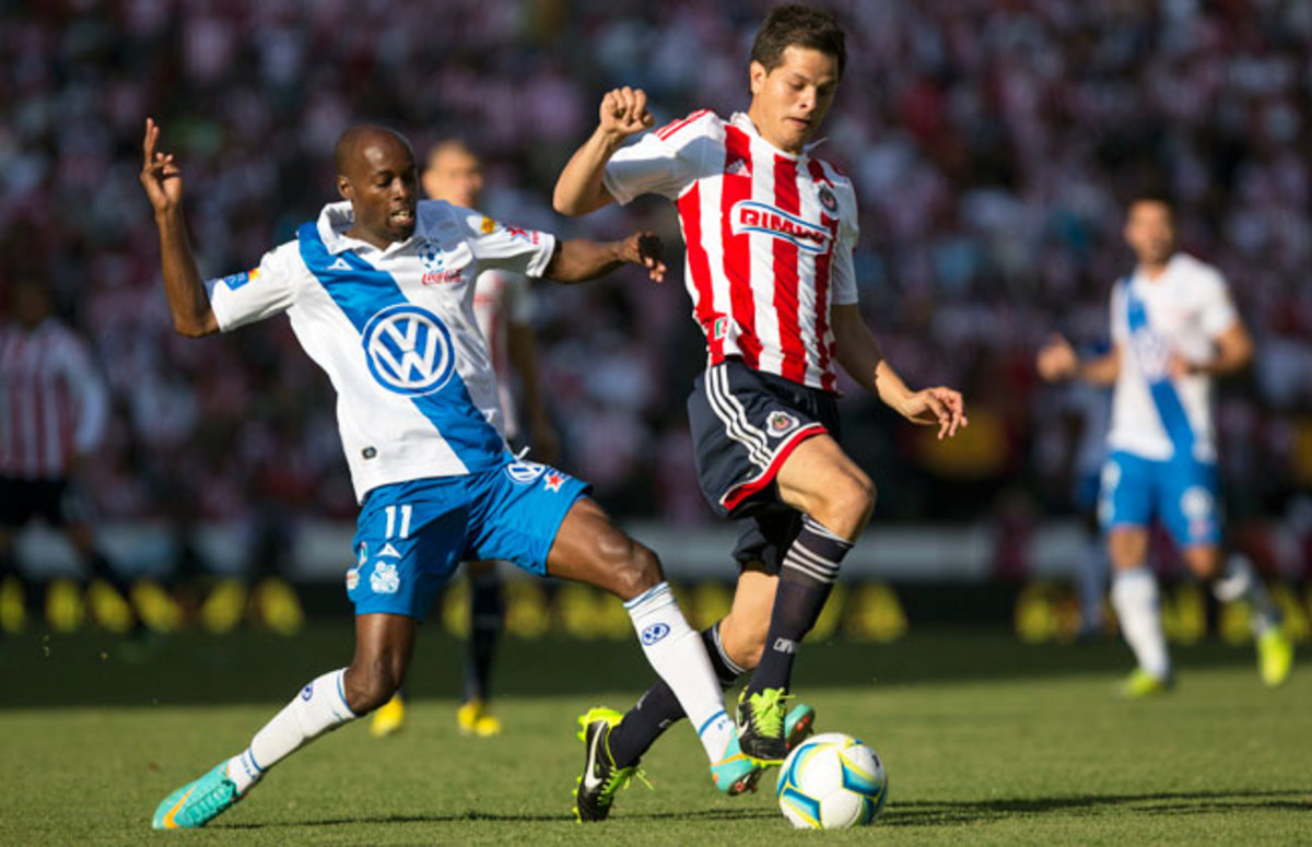 When not on national team duty, DaMarcus Beasley (left) plays for Puebla in Liga MX.