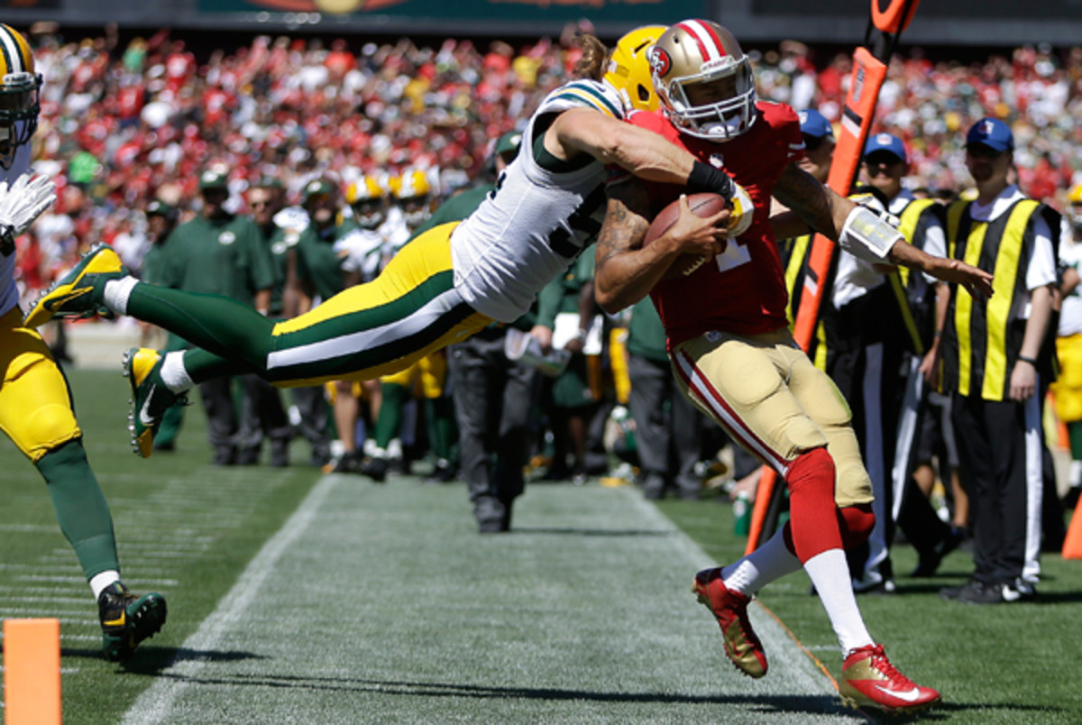 Clay Matthews hit 49ers quarterback Colin Kaepernick after he was several yards out of bounds. (Ben Margot/AP)