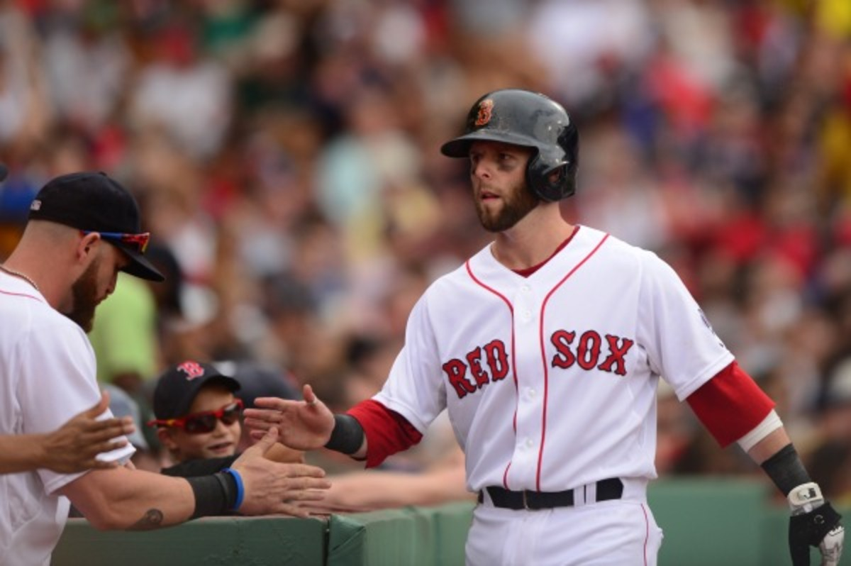 Dustin Pedroia and the Boston Red Sox are finalizing a contract extension that would keep him in Boston through the 2021 season (Michael Ivins/Getty Images)