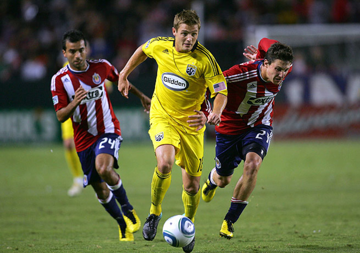 Robbie Rogers (center), seen here with the Columbus Crew, will be the first openly gay player in MLS.