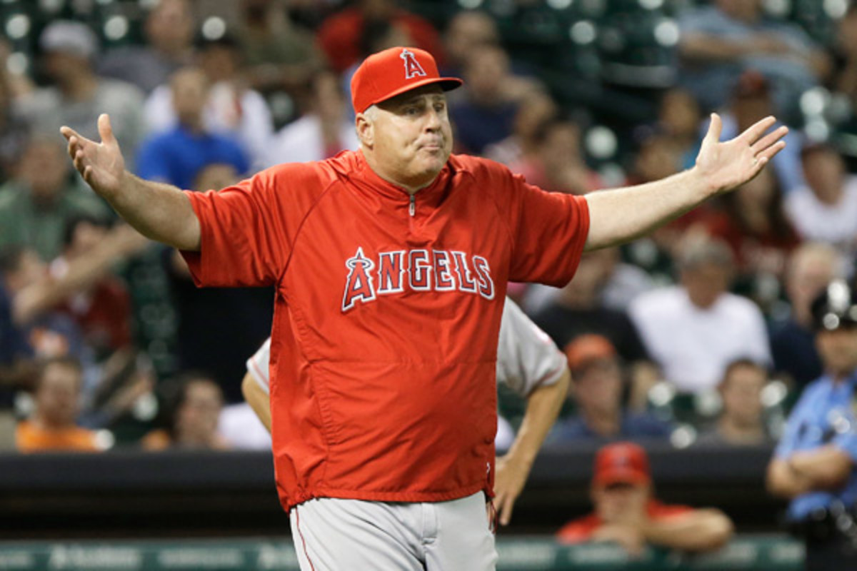 Mike Scioscia questions an Astros pitching change that the umpires mistakenly allowed Thursday night. (AP)