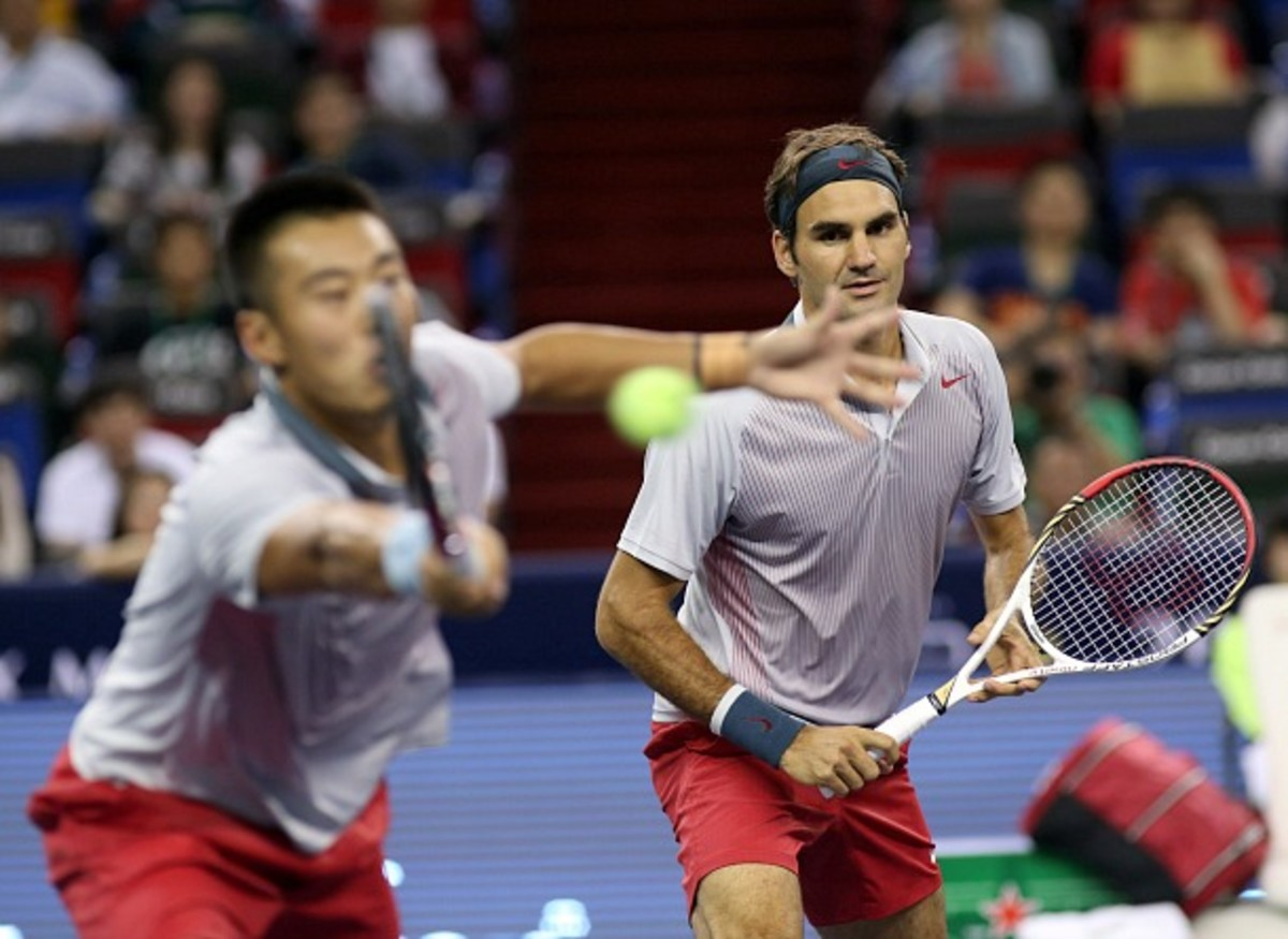 Roger Federer teamed up with Zhang Ze for his first doubles win of the year. (Photo courtesy of Shanghai Rolex Masters)