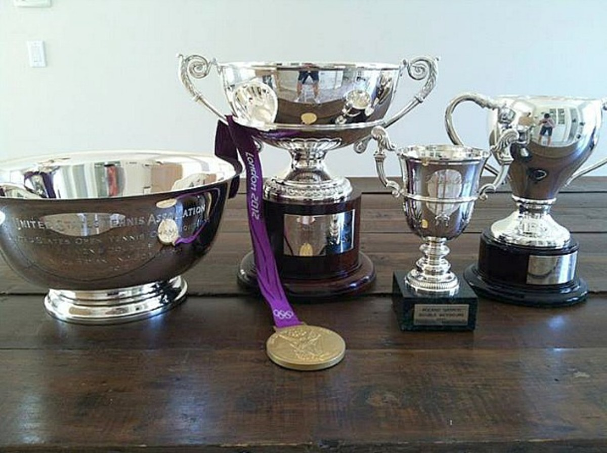 From left to right: 2012 U.S. Open trophy, 2012 Olympic gold medal, 2013 Australian Open trophy, 2013 French Open trophy, 2013 Wimbledon trophy. (Facebook)