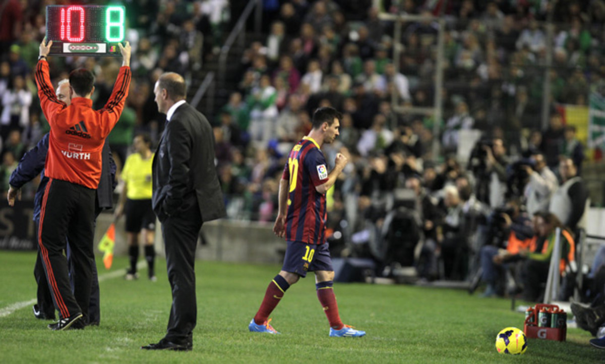 Barcelona star Lionel Messi walks off the field during Sunday's 4-1 victory at Real Betis after suffering his third leg injury of the season, and he will miss 6 to 8 weeks as a result.