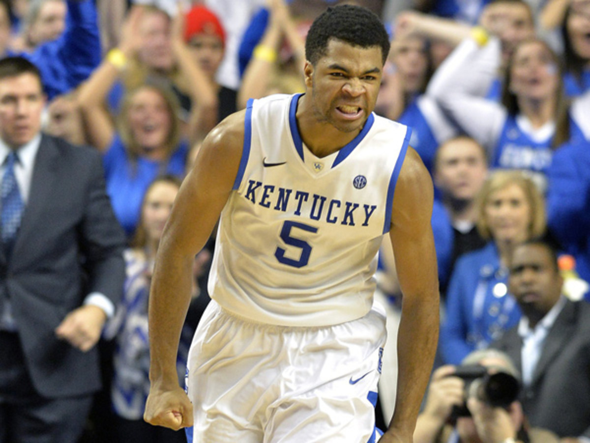 Andrew Harrison's 18 points helped Kentucky take down in-state rival Louisville. (Timothy D. Easley/AP)