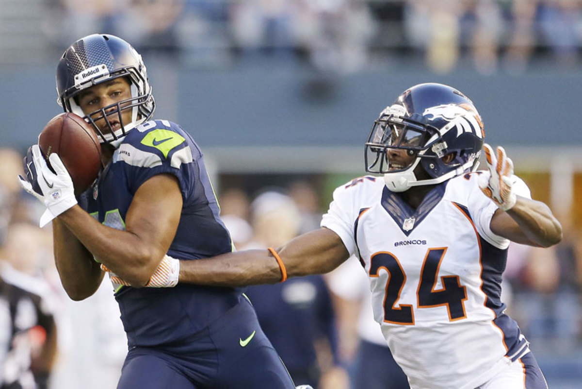 Golden Tate, looking a lot like Torrey Smith  last January, got the best of Champ Bailey in the Seahawks-Broncos game. (Elaine Thompson/AP)
