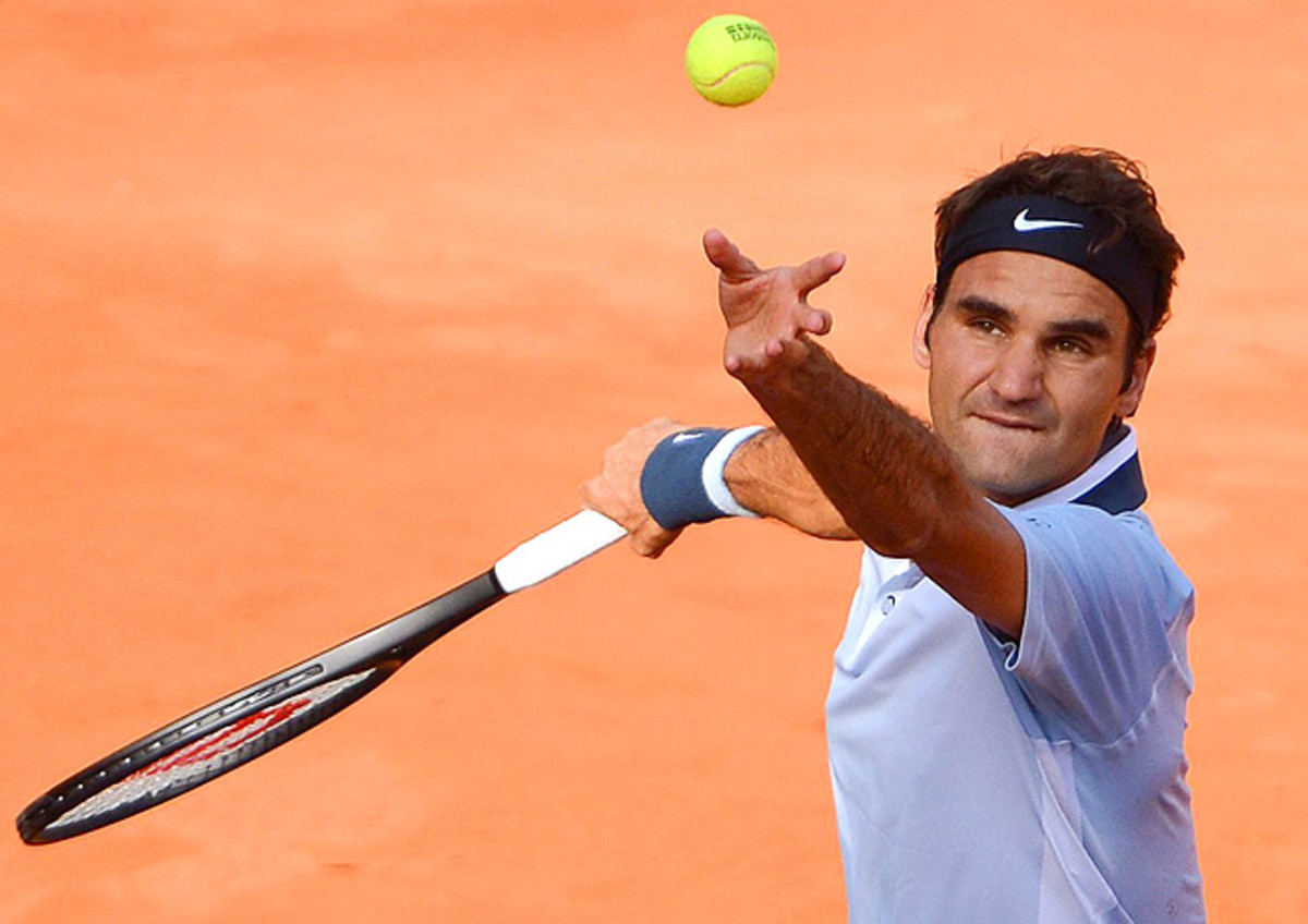 Roger Federer defeated Jan Hajek 6-4, 6-3 in his first tournament since losing at Wimbledon.