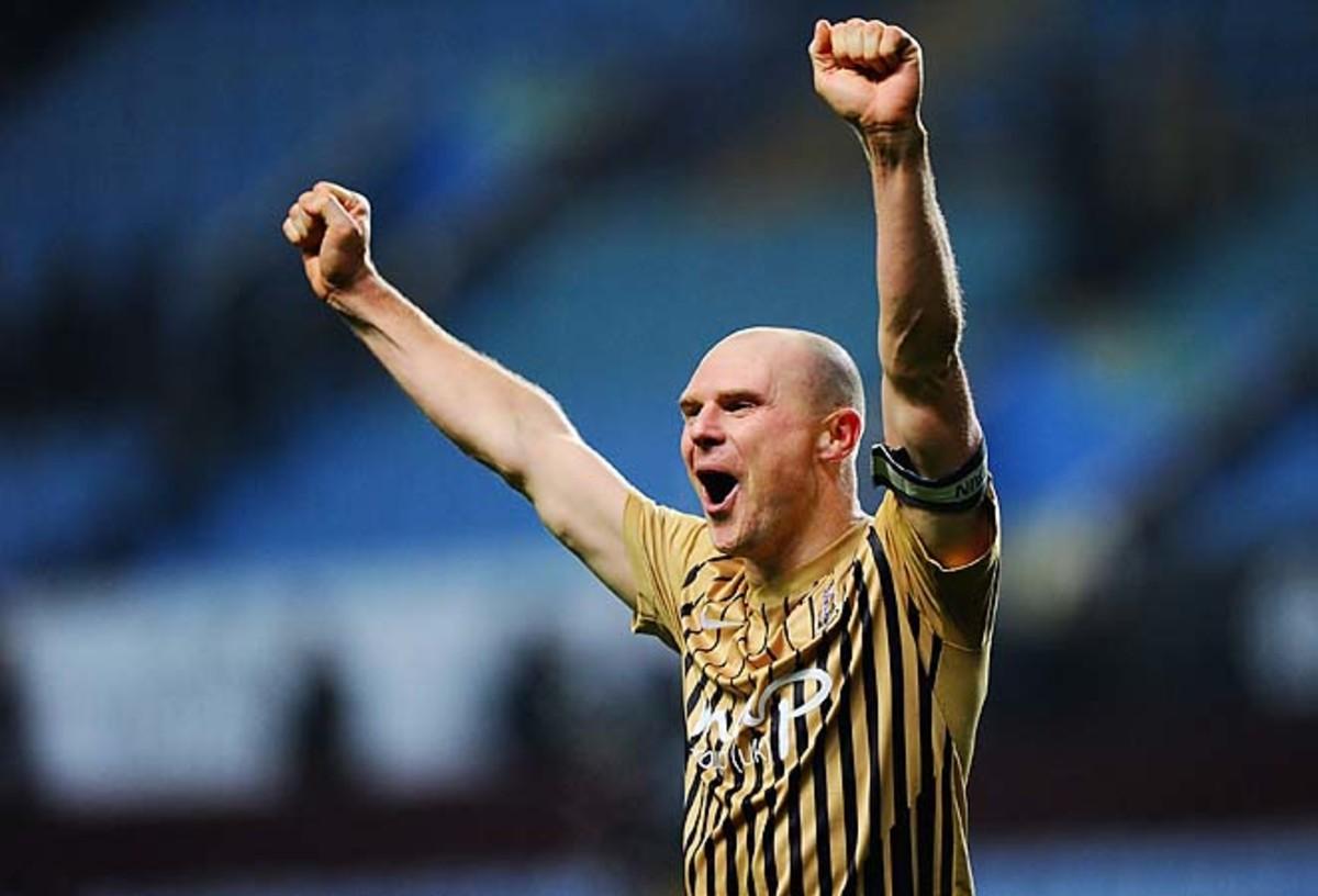 Gary Jones celebrates Bradford's semifinal victory over Aston Villa.