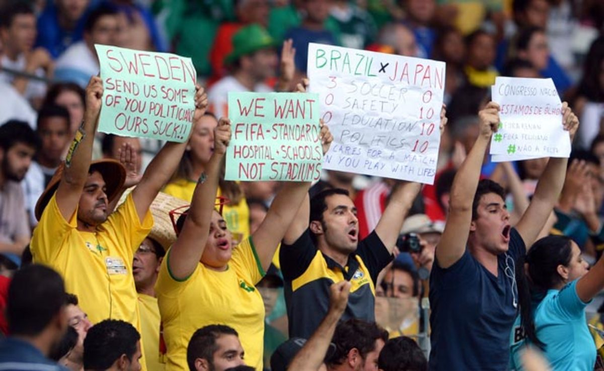 Fans hold up protest signs during a Confederations Cup match in Belo Horizonte.