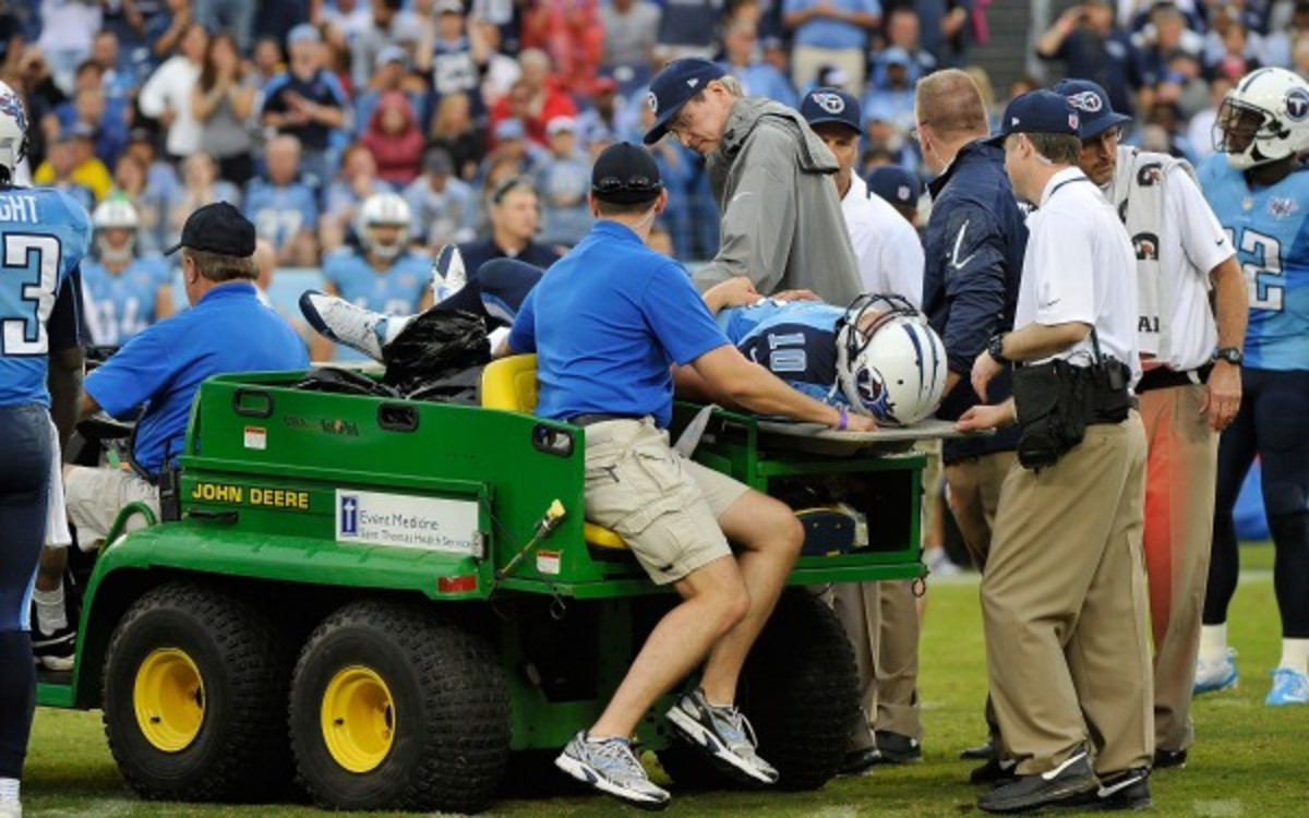 Titans quarterback Jake Locker was carted off after spraining his hip Sunday. (Frederick Breedon/Getty Images)
