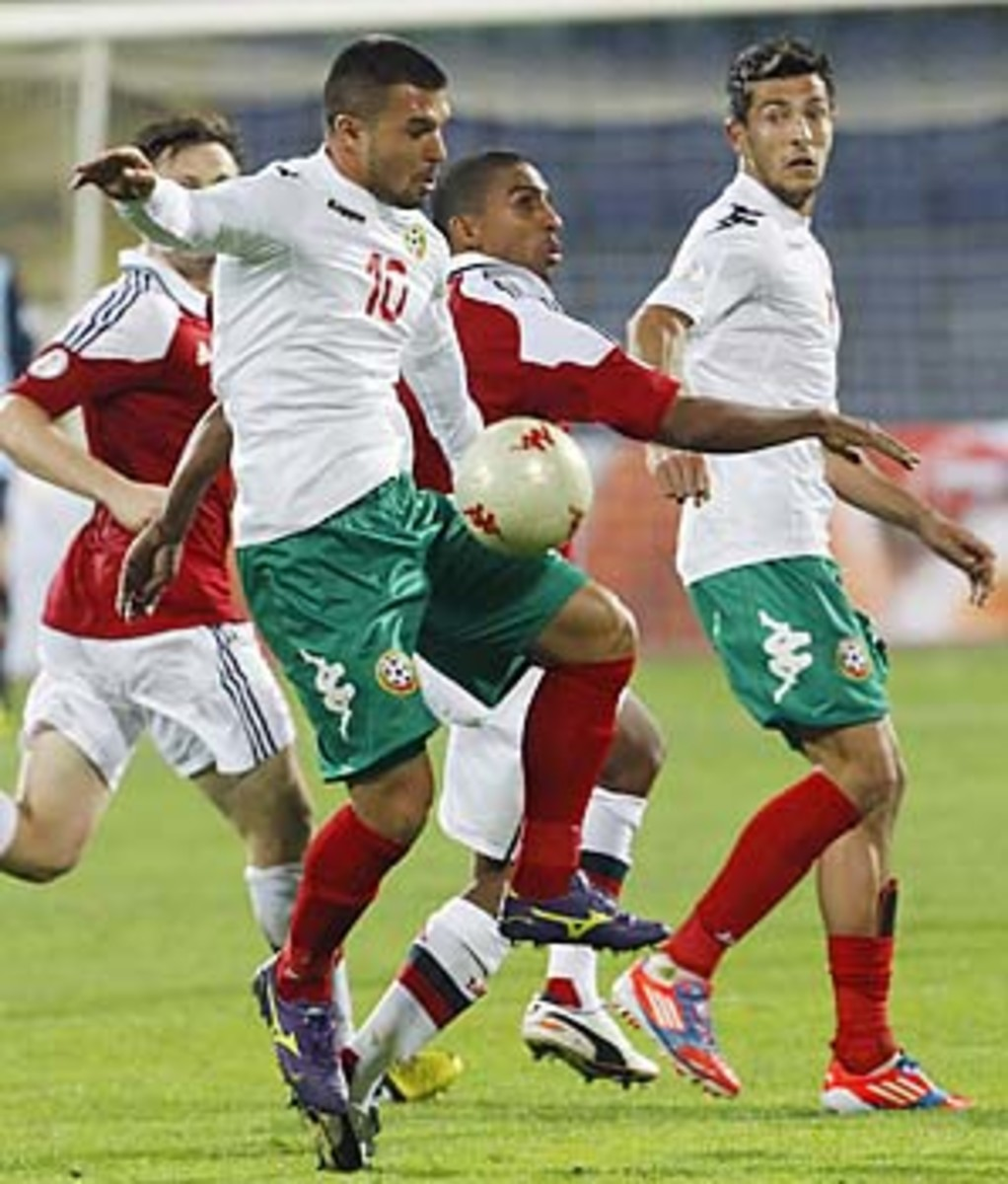 Patrick Mtiliga (center, in red) of Denmark was the subject of monkey chants by Bulgaria fans in October.