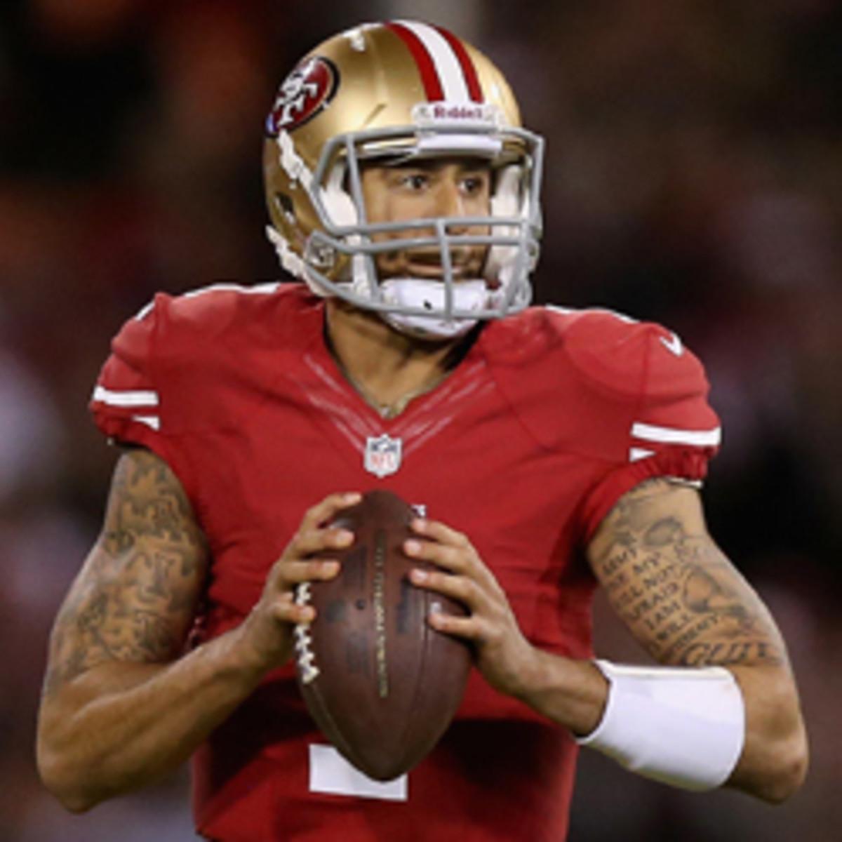 49ers coach Jim Harbaugh worries about quarterback Colin Kaepernick's workout regiment.  (Ezra Shaw/Getty Images)