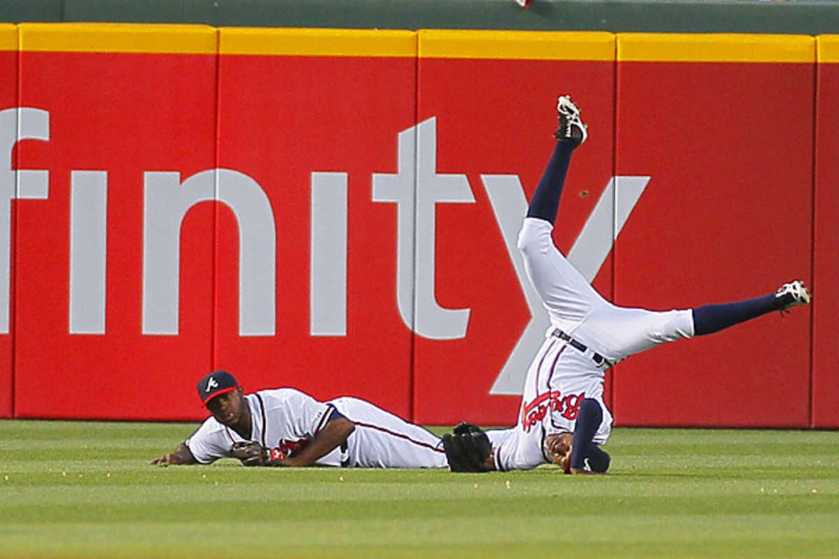B.J. Upton, (R), and Justin Upton collided at the end of the fourth inning in the second game of a doubleheader against the Mets. (Todd Kirkland/AP Photo)