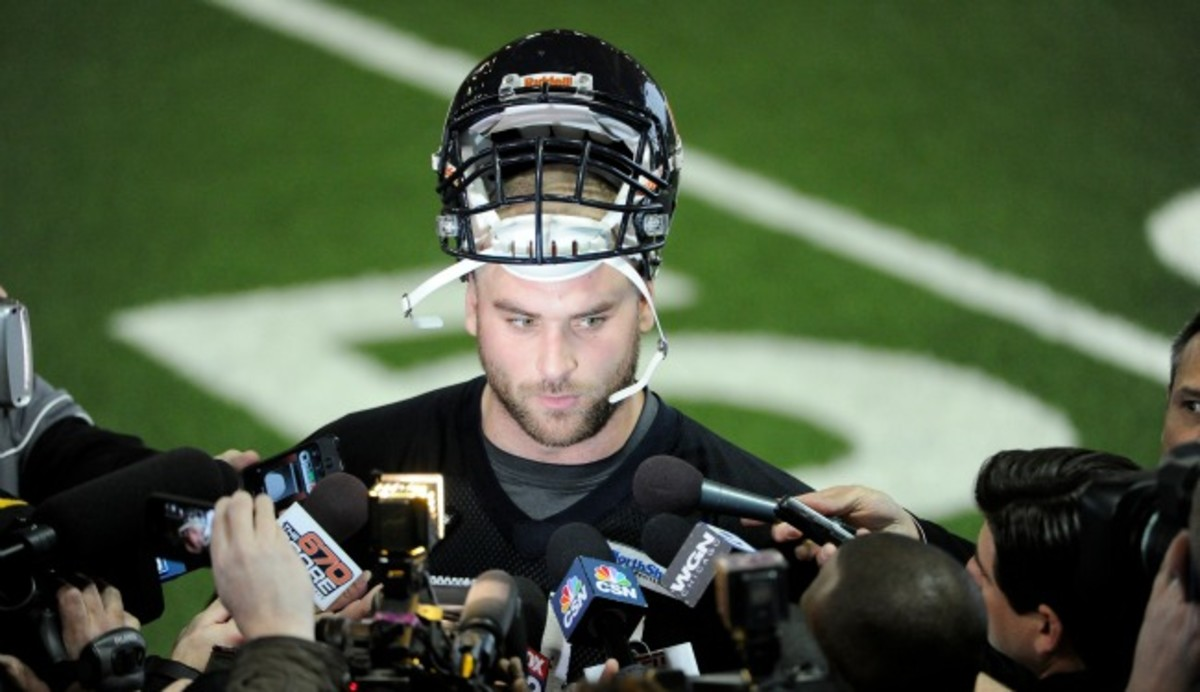 Kyle Long signs with the Bears. (Photo by David Banks/Getty Images)