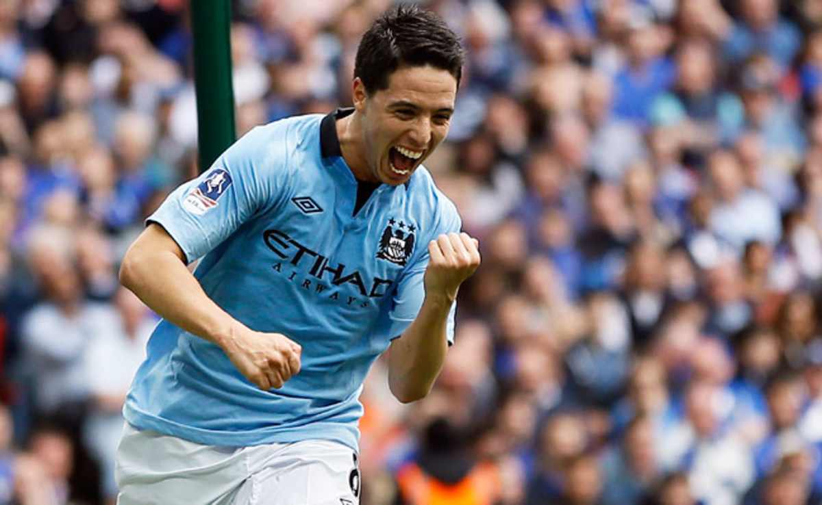 Samir Nasri celebrates after scoring a crucial goal against Chelsea in their FA Cup semifinal match.