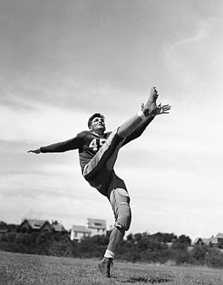 Baugh honed his punting skills as an All-America at TCU. (JFL/AP)