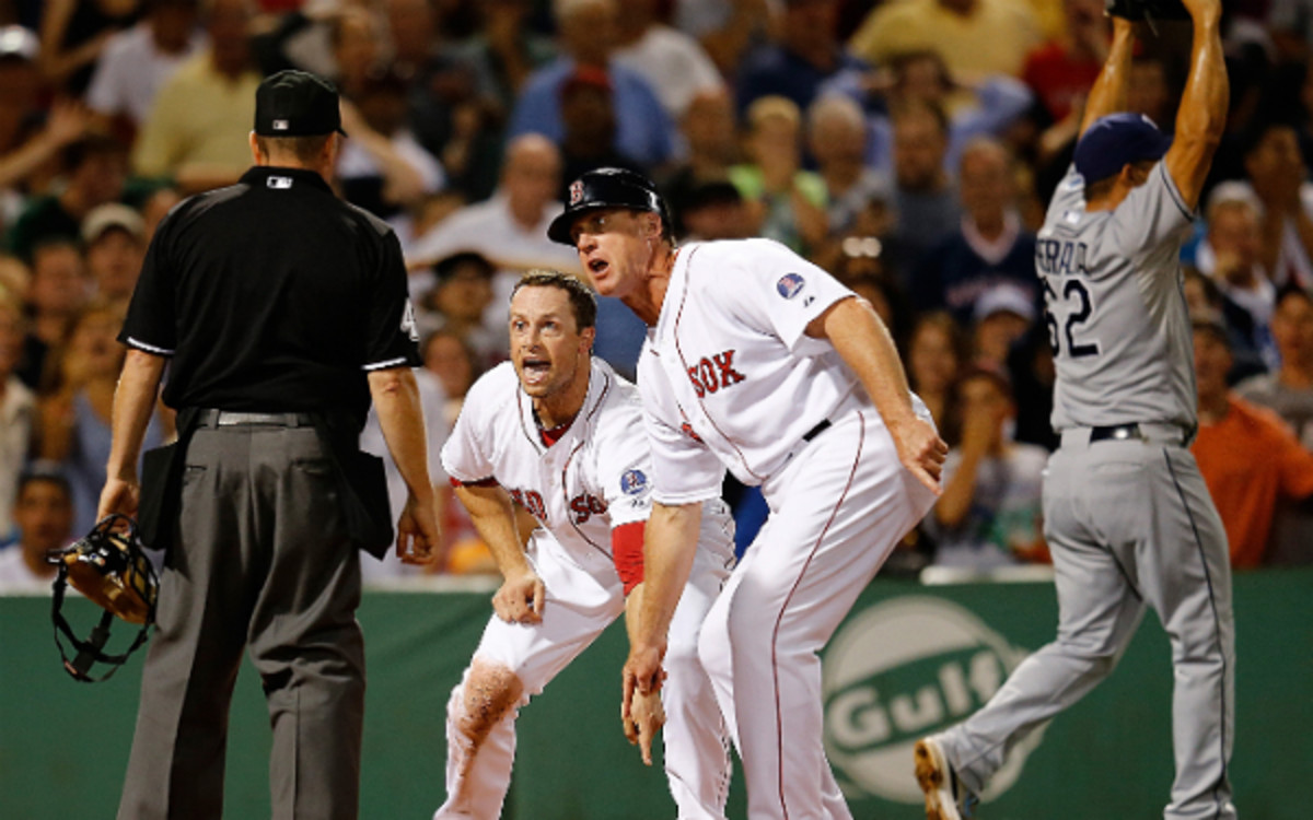 The Red Sox's Daniel Nava pleads his case to umpire Jerry Meals. (Jim Rogash/Getty Images)