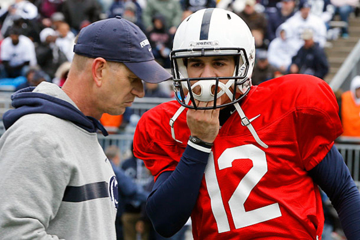 Steven Bench tells quarterbacks coach Charlie Fisher how excited he is about the Christian Hackenberg era, probably. (AP)