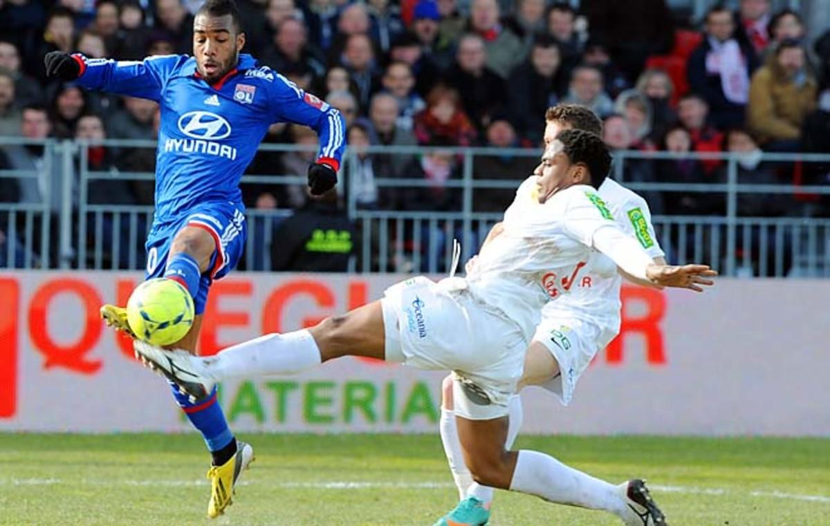 Brest's French midfielder Tripy Makonda (right) vies with Lyon's Argentinian forward Lisandro Lopez.