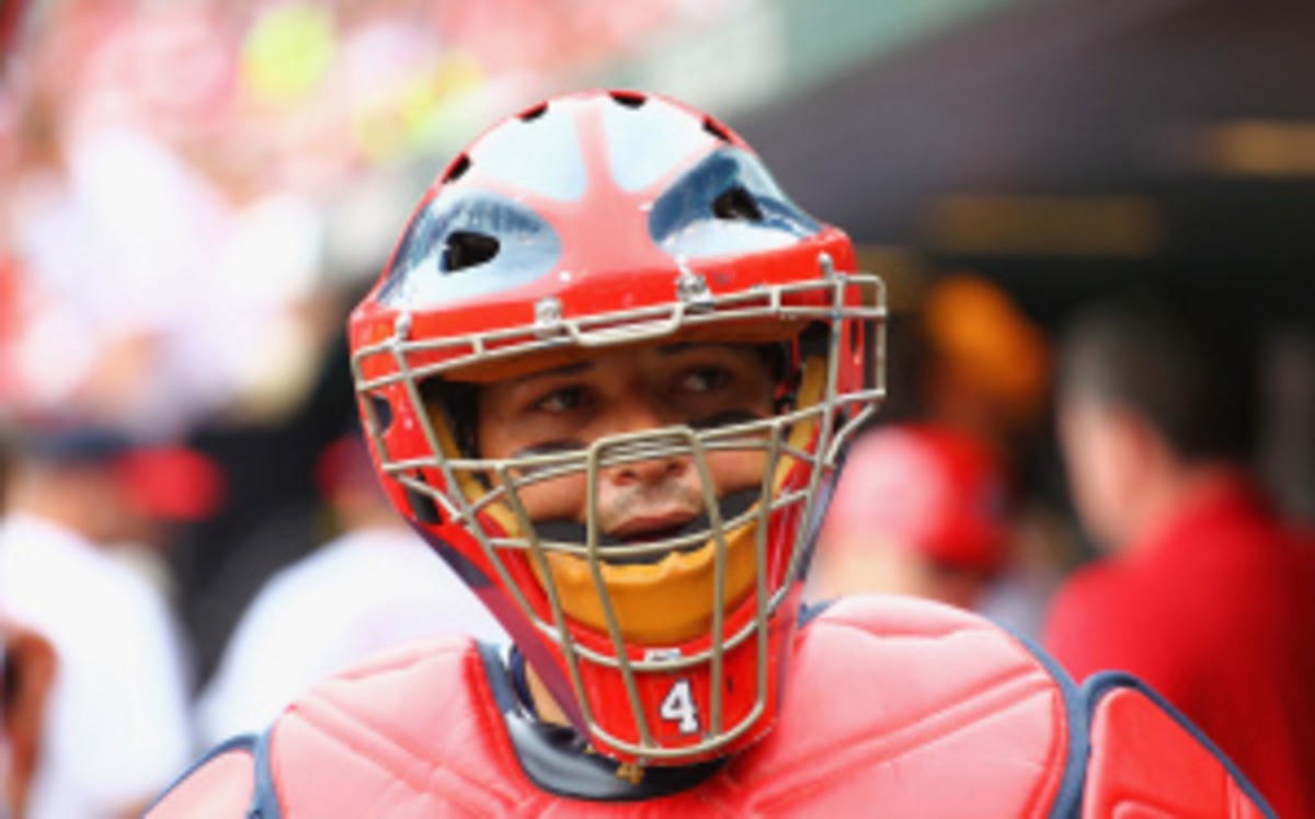 Yadier Molina was placed on the 15-day DL Wednesday to deal with chronic knee pain. (Dilip Vishwanat/Getty Images)