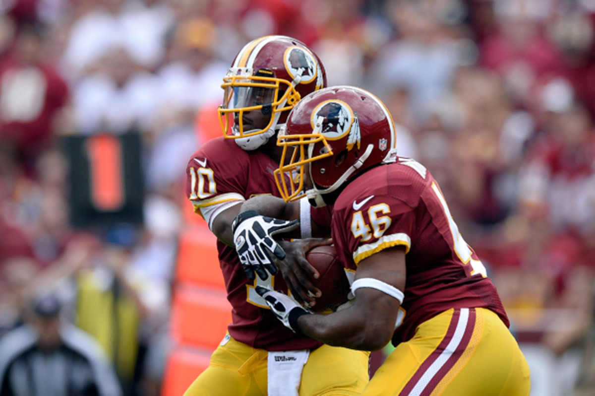 Robert Griffin III and Alfred Morris aren't confusing defenses as they did in 2012. (Patrick McDermott/Getty Images)