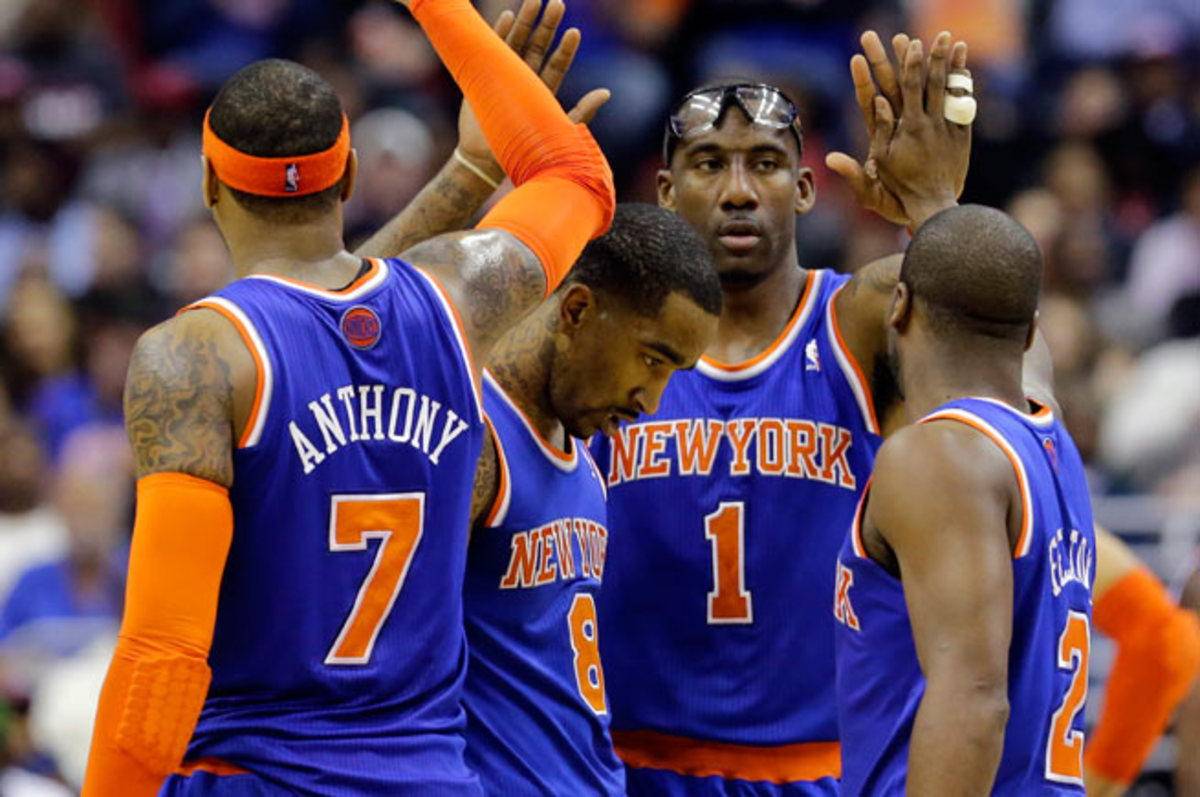 The Knicks are without two of their best players, J.R. Smith and Amar'e Stoudemire, as they open camp.