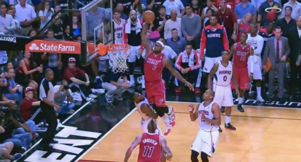 LeBron James dunks over Paul Millsap. (Sun Sports)