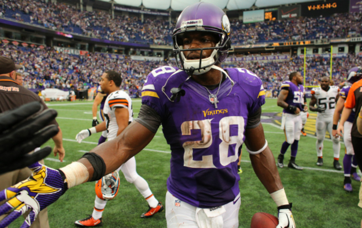 Adrian Peterson rushed for 1,266 yards this season. (Adam Bettcher/Getty Images)