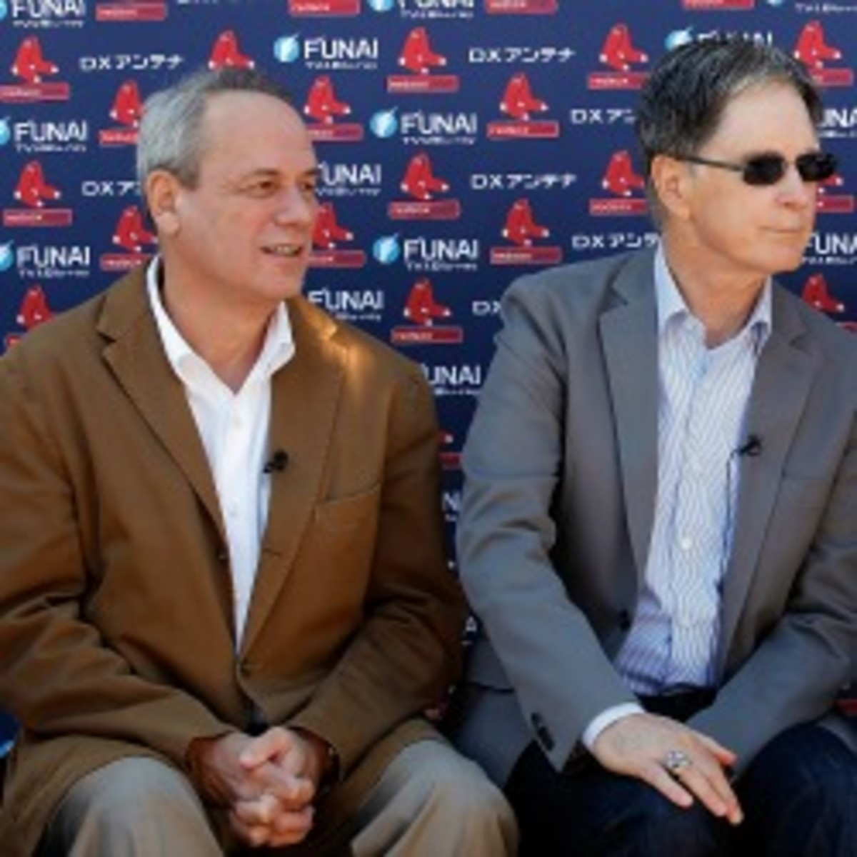 Red Sox President/CEO Larry Lucchino (left) and owner John Henry have been involved in the medical staff saga that has divided the team over the past several years. (J. Meric/Getty Images)