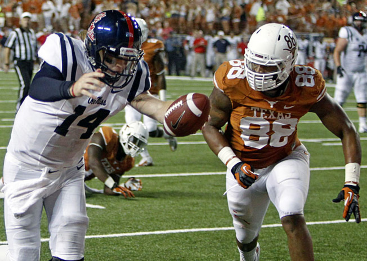 Quarterack Bo Wallace (14) and the Rebels outscored Texas 27-0 in the second half of Saturday's win.