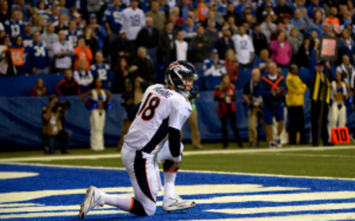 Broncos quarterback Peyton Manning missed practice Wednesday with an ankle injury but is expected to play Sunday at home vs. the Redskins. (Joe Amon/Getty Images)
