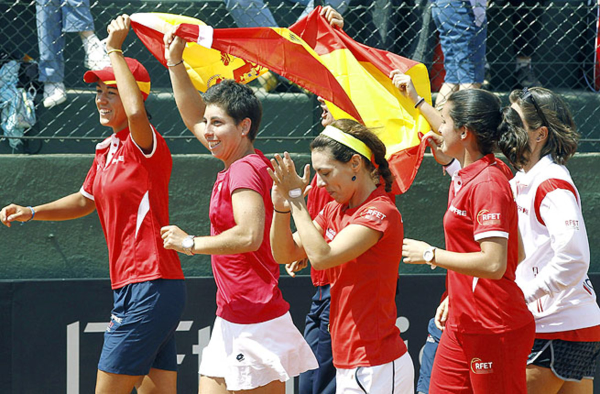 Silvia Soler (left) and her Spanish teammates celebrate after beating Japan in the third FedCup playoff match.