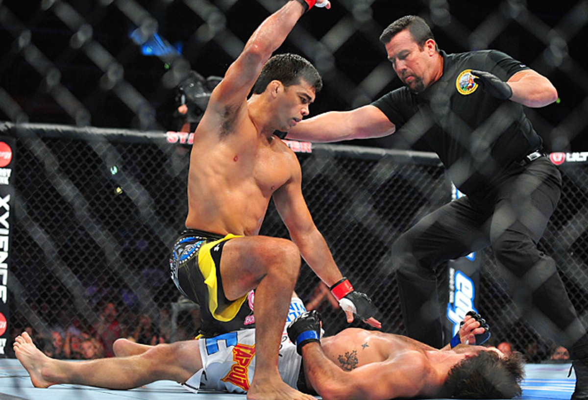 Lyoto Machida (top) scored a knockout win over Ryan Bader in last August's light heavyweight match.