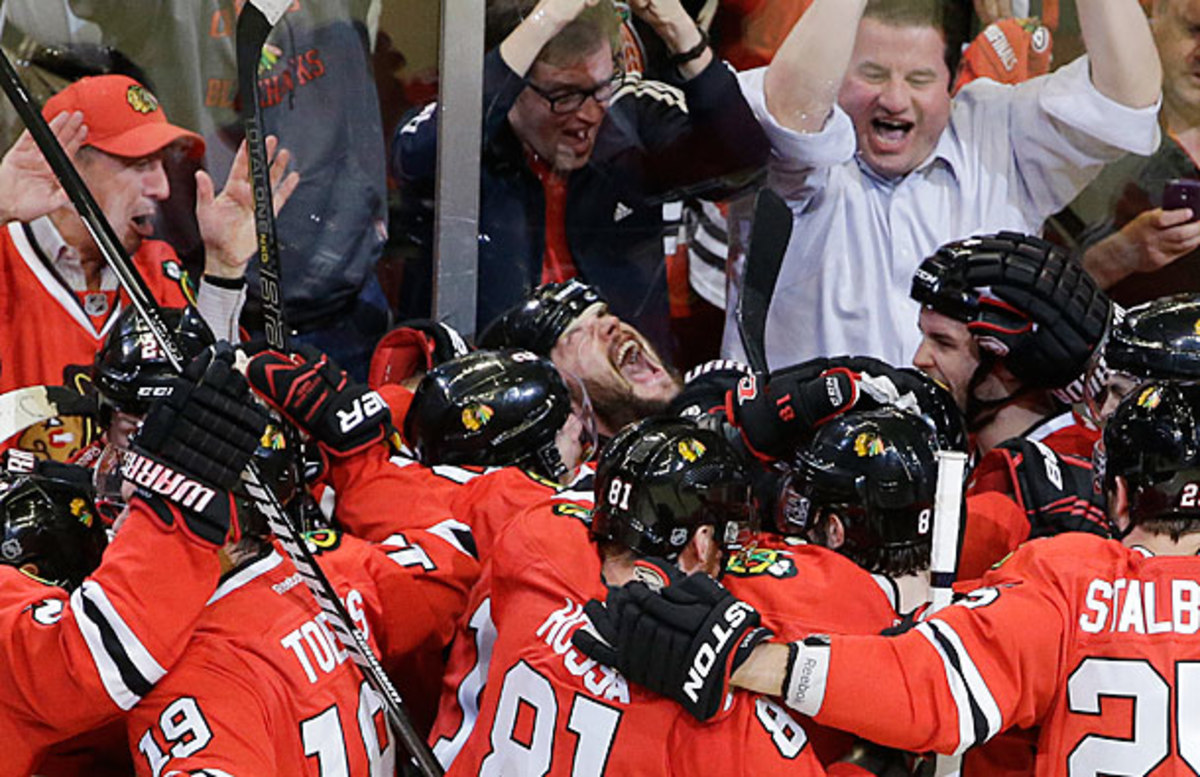 Brent Seabrook is mobbed by the Blackhawks after scoring the winning goal in Game 7 against the Red Wings