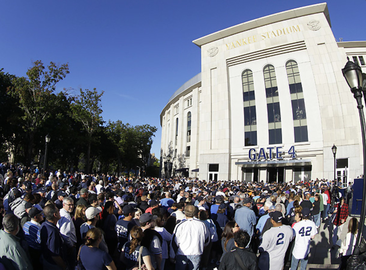 Fans packed outside of Yankee Stadium on Tuesday hoping to get a Mariano Rivera bobblehead doll. (AP)
