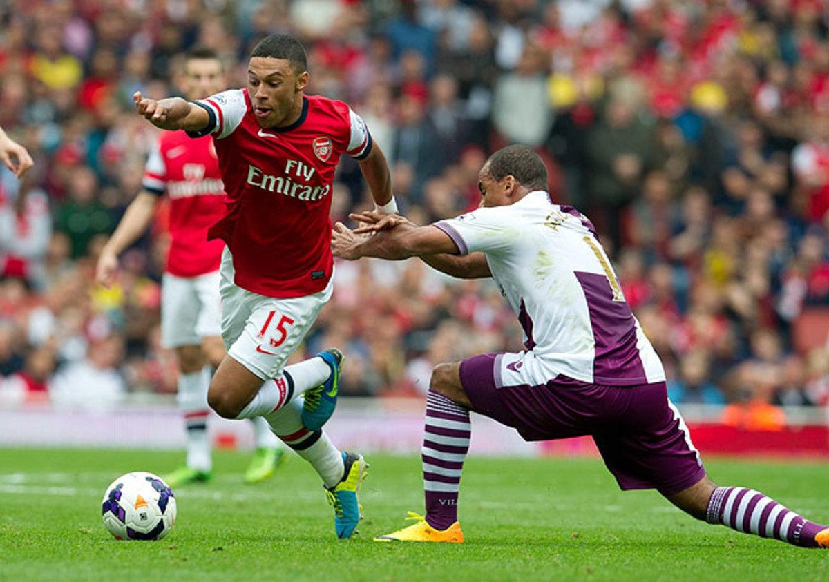 Alex Oxlade-Chamberlain (left) was hurt in Arsenal's season-opening loss to Aston Villa.