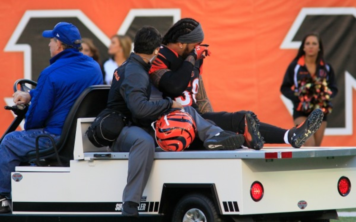 Cincinnati Bengals linebacker Rey Maualuga is carted off the field after injuring his knee. (AP Photo/Tom Uhlman)