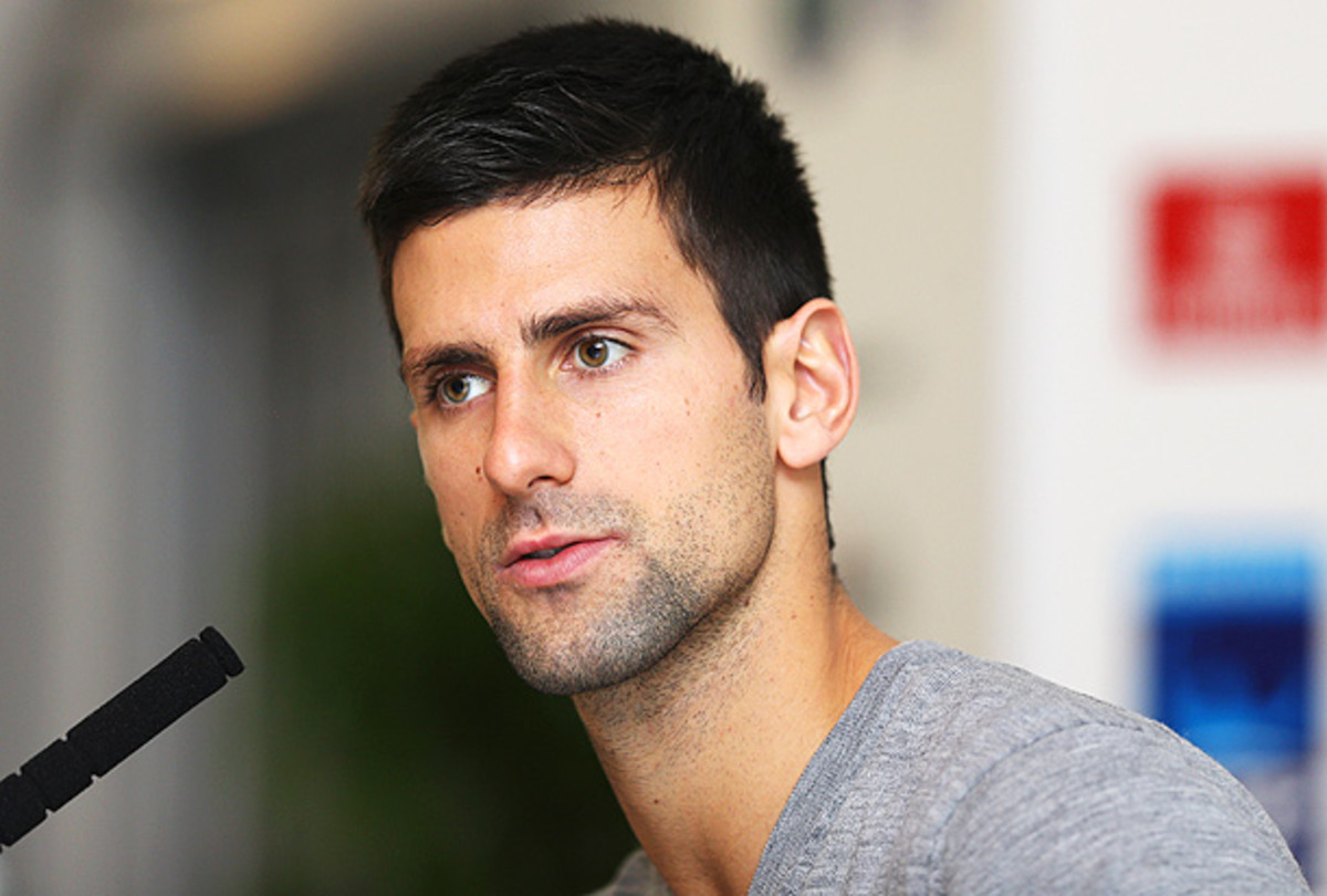 Novak Djokovic played Roger Federer for the first time this season in the Paris Masters semifinals. (Clive Brunskill/Getty Images)