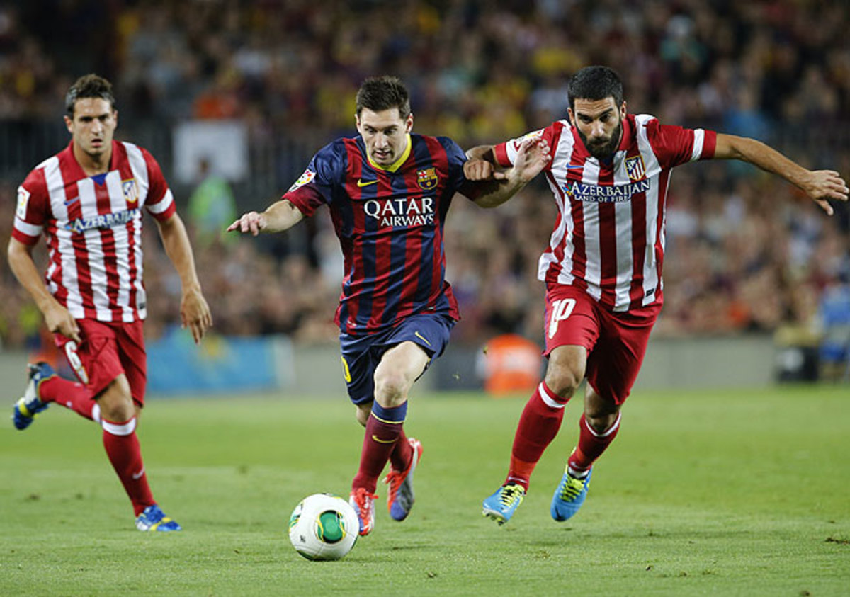 Although a healthy Lionel Messi (center) didn't score, Barcelona still managed to take the Super Cup.