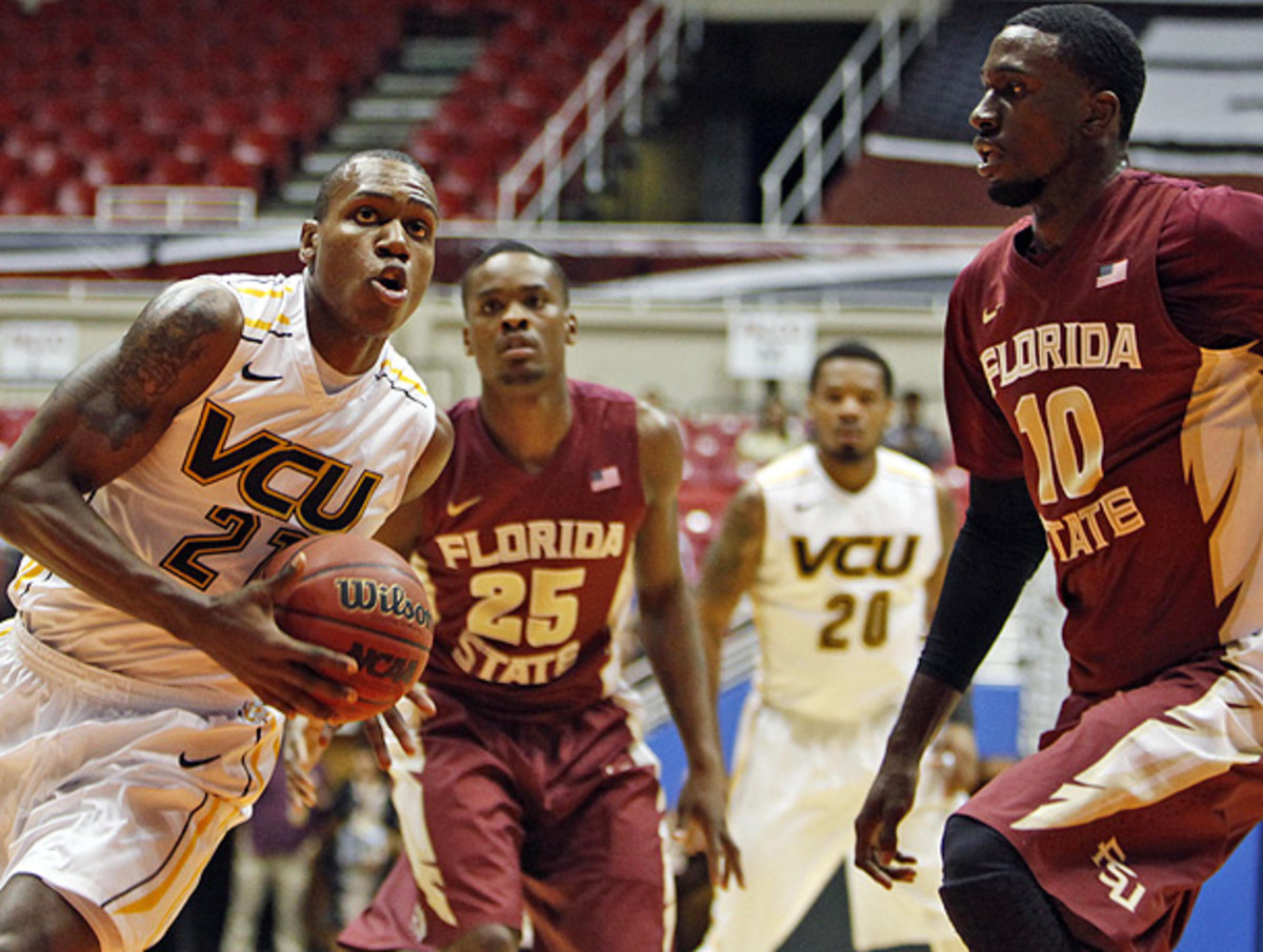 Okaro White (right) and Florida State put the clamps on VCU's offense en route to an upset win. (Ricardo Arduengo/AP)