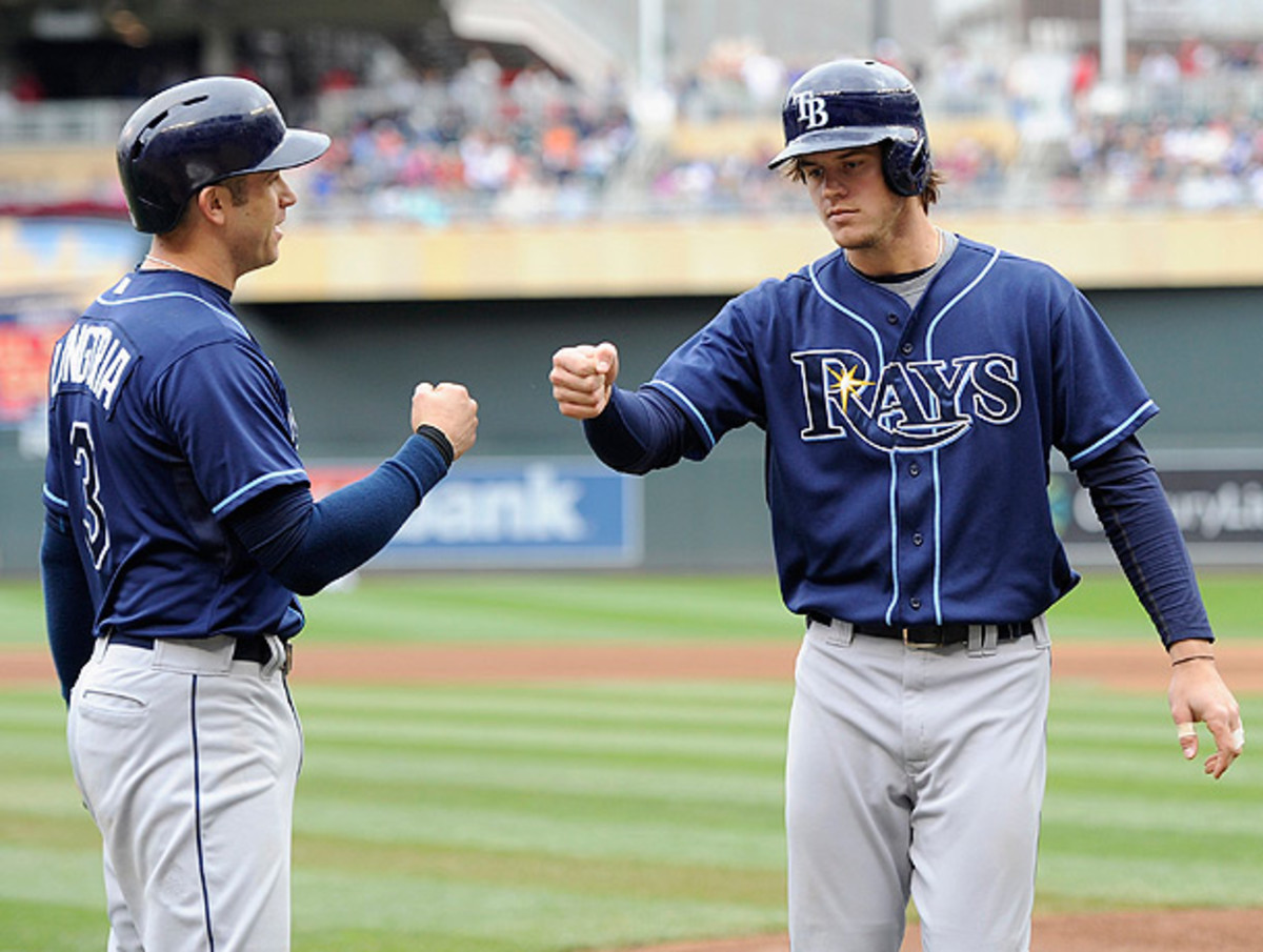 Wil Myers (right) and Evan Longoria are part of a Rays team that's trying to avoid an embarrassing collapse. (Hannah Foslien/Getty Images)