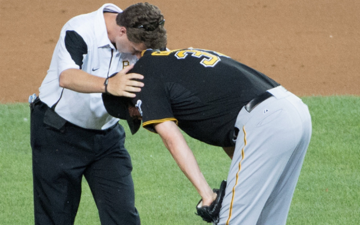 Jason Grilli bends down after suffering an arm injury on Monday. (MCT/Getty Images)