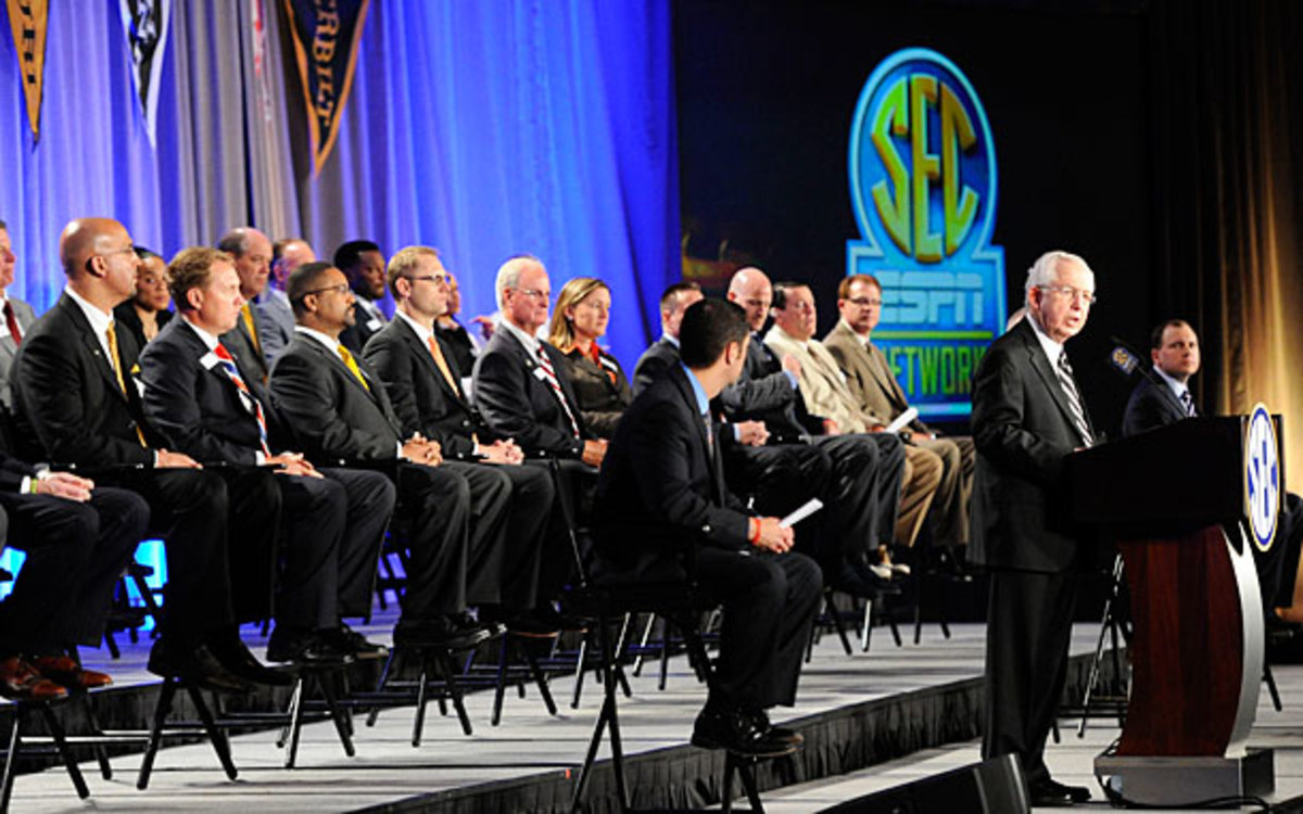 The SEC Network: Not short on money, or coaches who wish they'd worn more comfortable pants to this press conference. (AP)